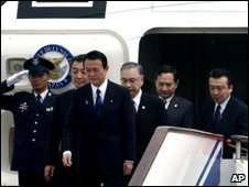 Prime Minister of Japan Taro Aso, fourth from right, arrives in Beijing