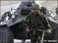 A Turkish soldier patrols on a road near the Turkey-Iraq border