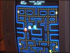 TV showing Pac Man turned on its side