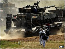 Pakistan military equipment is moved along a road in Buner district