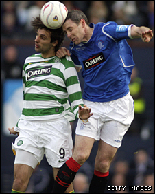 Celtic's Georgios Samaras challenges Rangers defender David Weir for the ball