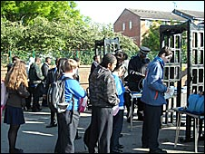 Pupils queue to be screened