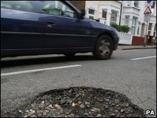 A car and a pothole