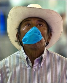 A Mexican wears a surgical mask trying to prevent contagion of the swine flu virus at Mexico City's international airport