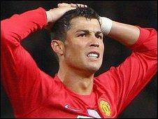 Man Utd winger Cristiano Ronaldo rues his shot hitting the Arsenal crossbar