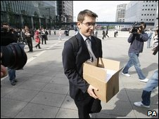 Lehman Brothers employee leaving with box in hand