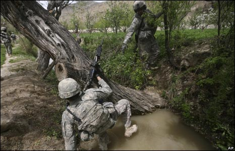 A US soldier of the 10th Mountain Division tries to cross an irrigation channel in Wardak province on April 28, 2009