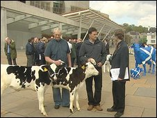 Dairy farmers outside the Scottish Parliament