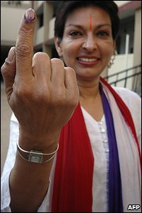 Independent candidate Mallika Sarabhai displays the indelible ink mark on her finger after voting in Ahmadabad
