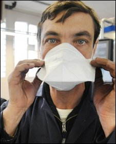 A man works in a surgical masks factory in Vernet, France, 30 April.