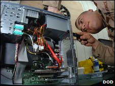 US Airman fixing PC