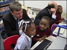 Ed Balls and Jim Rose with children on PCs