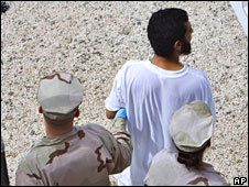 A detainee is escorted by US guards at the Guantanamo Bay prison camp (file picture)