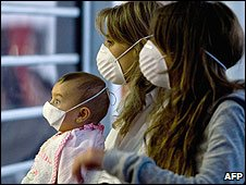 Two women and a baby wearing masks at Mexico International airport (Photo: LUIS ACOSTA/AFP/Getty Images)