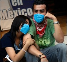 A young Mexican couple wears surgical masks to avoid swine flu contamination
