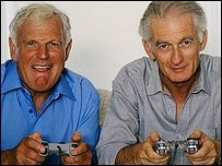 Two older men playing with a games console