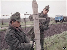 Hungarian guards cut a hole in the border with Austria