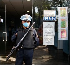 Policeman outside respiratory illnesses centre in Mexico City