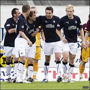 Carl Finnigan is mobbed after scoring for Falkirk