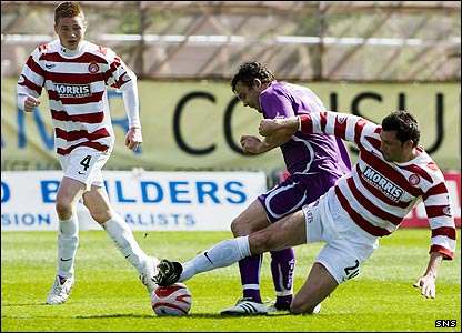 David Fernandez is tackled by Martin Canning