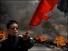 An anti-government protester in Kathmandu after the PM sacked the army chief