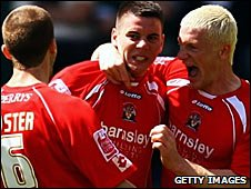 Adam Hammill (centre) celebrates his equaliser with his Barnsley team-mates