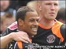 Blackpool goal-scorer DJ Campbell is congratulated by team-mate Keith Southern