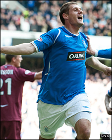 Andrius Velicka celebrates his goal at Ibrox