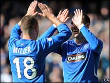 Rangers striker Kenny Miller congratulates goalscorer Kris Boyd