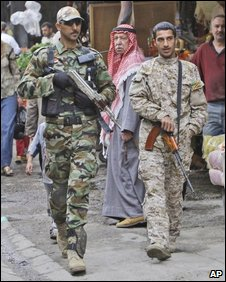 Awakening militia members on patrol in Baghdad