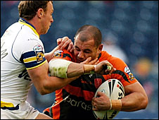 Hull KR's Ben Galea is tackled by Warrington's Micky Higham