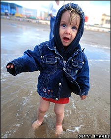 Child at Blackpool in gusty weather