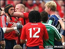 Quinlan (in cap) is held back from Leinster captain Cullen (far right)