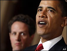 President Obama makes his speech, flanked by Timothy Geithner