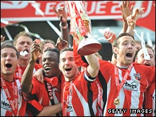 Brentford celebrate with the League Two trophy