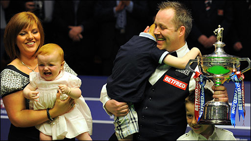 John Higgins and his wife and family