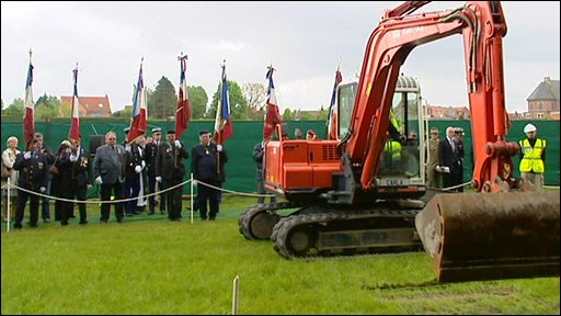 Digger removing soil at ceremony in Fromelles