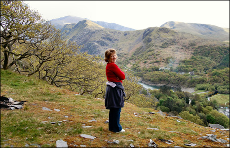 Alwen Jones enjoys the view over Llanberis, Gwynedd from above Vivian Quarry. Snowdon can be seen in the background (Gareth Jones).
