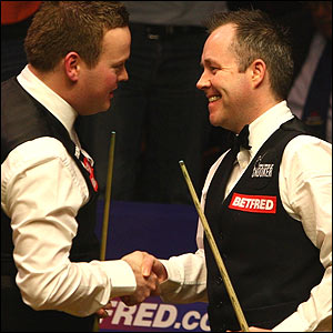 Shaun Murphy and John Higgins shake hands at the end of the match
