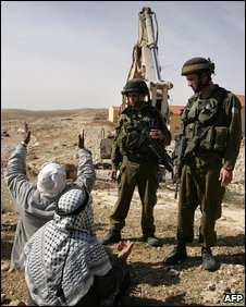 Palestinians protest at expansion of an Israeli settlement in the occupied West Bank
