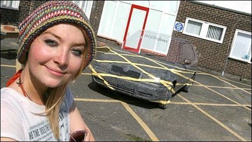 Sara Watson in front of her car