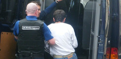 Suspected illegal immigrant being detained