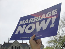 "A supporter of same-sex marriage holds up a banner which reads: ""Marriage Now!"""