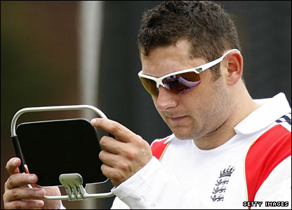 England debutant Tim Bresnan checks his sunglasses in a mirror