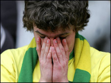 A distraught Norwich fan