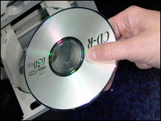 CD being loaded into computer