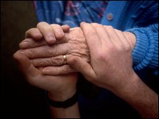 Care worker and a patient's hands