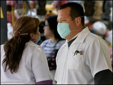 Pharmacy worker wearing surgical mask