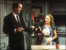 John Cleese, as Basil Fawlty, and Connie Booth, as Polly