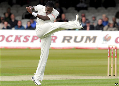 Fidel Edwards kicks the turf in frustration after another catch is put down